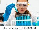 young woman scientist working... | Shutterstock . vector #1343886083