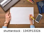 blank paper lying on the table... | Shutterstock . vector #1343913326