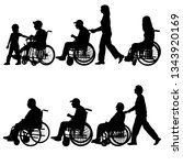 silhouettes disabled in a wheel ... | Shutterstock .eps vector #1343920169
