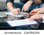 hands of two men signed the... | Shutterstock . vector #134396354