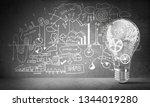 lightbulb with multiple gears... | Shutterstock . vector #1344019280