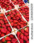 red strawberries in street...