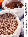 beans in white coat in market...