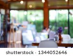 interior coffee shop with woman ... | Shutterstock . vector #1344052646