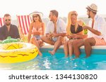 group of friends at a poolside...   Shutterstock . vector #1344130820