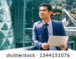 businessman carrying notebooks... | Shutterstock . vector #1344151076