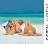 family on beach  woman with... | Shutterstock . vector #1344159476