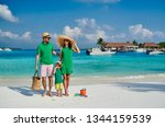 family on beach  young couple... | Shutterstock . vector #1344159539
