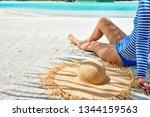 woman sitting on beach under... | Shutterstock . vector #1344159563