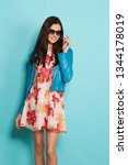 young fashion woman in blue... | Shutterstock . vector #1344178019