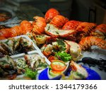 seafood lobster tails and... | Shutterstock . vector #1344179366