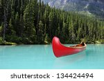 Red Canoe On Glacial Lake