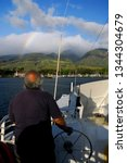 Captain Steering The Molokai...