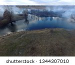the smoke from the burning of... | Shutterstock . vector #1344307010