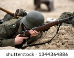 a german soldier in a trench... | Shutterstock . vector #1344364886