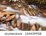 Water Flows Swiftly Over A...