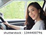 asian women driving a car and... | Shutterstock . vector #1344400796
