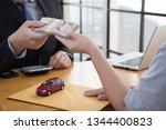 women sending contract and... | Shutterstock . vector #1344400823