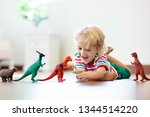 Child Playing With Colorful To...