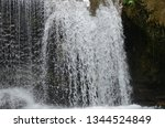 isolated waterfall in tropics | Shutterstock . vector #1344524849