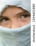 young girl with a veil covering ... | Shutterstock . vector #1344601880