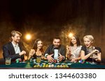 poker players sitting around a... | Shutterstock . vector #1344603380