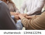 group of people holding their... | Shutterstock . vector #1344612296