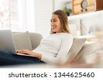 young woman using her laptop at ... | Shutterstock . vector #1344625460