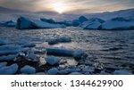 sundown in the glacier lagoon... | Shutterstock . vector #1344629900