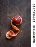 half peeled red orange on a... | Shutterstock . vector #1344652916