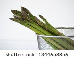 fresh green asparagus on white... | Shutterstock . vector #1344658856