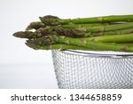 fresh green asparagus on white... | Shutterstock . vector #1344658859