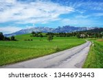 alpine road across green...   Shutterstock . vector #1344693443