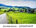 alpine road across green...   Shutterstock . vector #1344693449