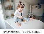 a little sweet little girl with ... | Shutterstock . vector #1344762833