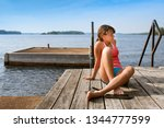 young woman sitting on a wooden ... | Shutterstock . vector #1344777599