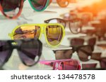 many colorful sunglasses on... | Shutterstock . vector #134478578