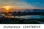 at sunset several tourists... | Shutterstock . vector #1344788519