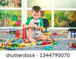 children playing with wooden... | Shutterstock . vector #1344790070
