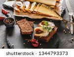 Stock photo sandwich with smoked mackerel fish with spices on dark stone background smoked fish mediterranean 1344793373