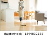 housewife cleaning with vacuum... | Shutterstock . vector #1344832136