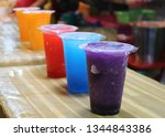 drinks in plastic cups with... | Shutterstock . vector #1344843386