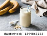 protein banana smoothie in jar  ... | Shutterstock . vector #1344868163