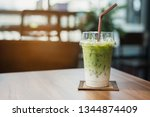 iced matcha green tea latte. | Shutterstock . vector #1344874409