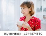 woman in a cafe drinking coffee | Shutterstock . vector #1344874550