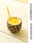 fresh pineapple smoothie glass... | Shutterstock . vector #1344884510
