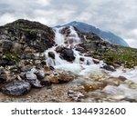 mountain waterfall stream in... | Shutterstock . vector #1344932600