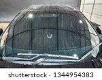 droplet on the car hood  ... | Shutterstock . vector #1344954383
