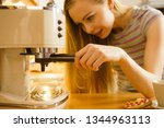 woman in kitchen making hot... | Shutterstock . vector #1344963113
