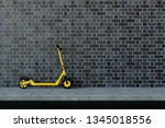 yellow e scooter parked on a... | Shutterstock . vector #1345018556